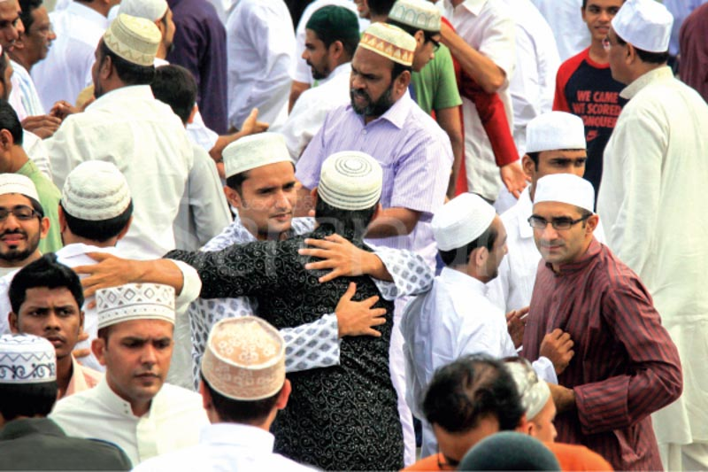 The holy month of ramadan muslim men in colombo hug each other in a customary greeting on eid ul fitr a festival which marks the end of the period of fasting during the holy month m4hsunfo